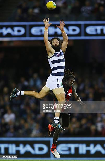 Jimmy Bartel of the Cats attempts a high mark over Anthony McDonaldTipungwuti of the Bombers during the round 20 AFL match between the Geelong Cats...
