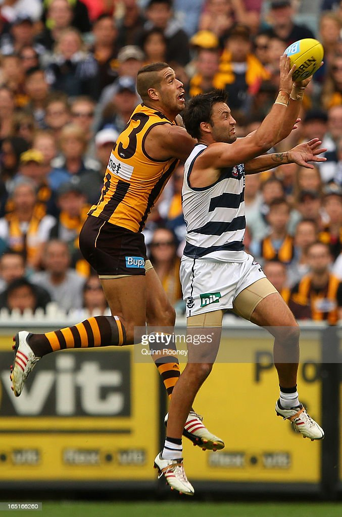 Jimmy Bartel of the Cats marks infront of <a gi-track='captionPersonalityLinkClicked' href=/galleries/search?phrase=Lance+Franklin&family=editorial&specificpeople=561332 ng-click='$event.stopPropagation()'>Lance Franklin</a> of the Hawks during the round one AFL match between the Hawthorn Hawks and the Geelong Cats at the Melbourne Cricket Ground on April 1, 2013 in Melbourne, Australia.