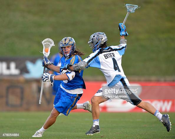 Jimmy Bitter of the Ohio Machine defends Josh Hawkins of the Charlotte Hounds during their game at American Legion Memorial Stadium on June 5 2015 in...