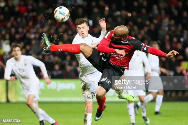 Jimmy Briand of Guingamp and Frederic Guilbert of Caen during the Ligue 1 match between EA Guingamp and SM Caen at Stade du Roudourou on February 4...