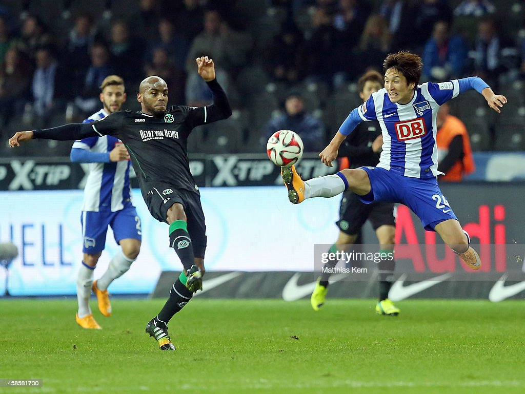 Jimmy Briand of Hannover battles for the ball with Genki Haraguchi of Berlin during the Bundesliga match between Hertha BSC and Hannover 96 at...