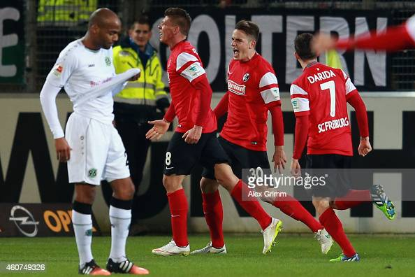 Jimmy Briand of Hannover reacts as Mike Frantz of Freiburg celebrates his team's first goal with team mates Christian Guenter and Vladimir Darida...