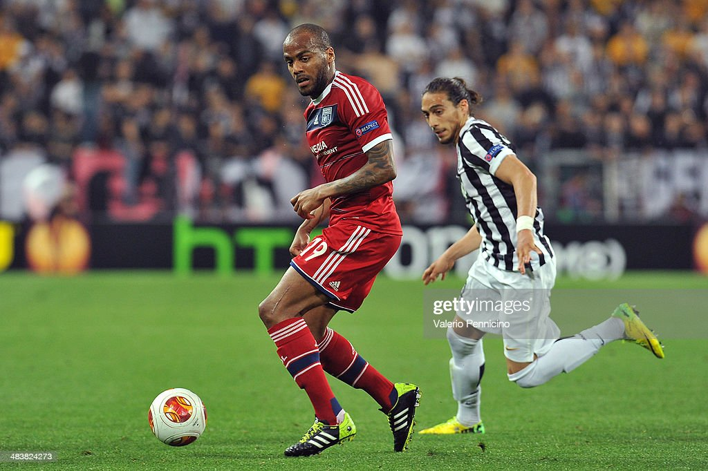 Jimmy Briand (L) of Olympique Lyonnais in action against Martin Caceres of Juventus during the UEFA Europa League quarter final match between Juventus and Olympique Lyonnais at Juventus Arena on April 10, 2014 in Turin, Italy.