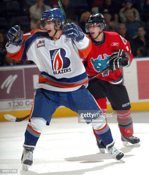 Jimmy Bubnick of the Kamloops Blazers and Dylan Hood of the Kelowna Rockets watch a goal against the Kelowna Rockets at Prospera Place on September...