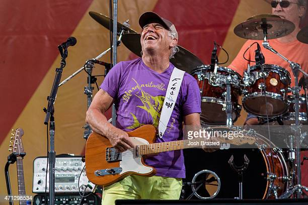 Jimmy Buffett and the Coral Reefer Band performs during the New Orleans Jazz Heritage Festival at the Fair Grounds Race Course on April 26 2015 in...