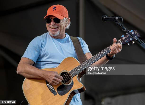 Jimmy Buffett performs with Dave Matthews and Tim Reynolds during the New Orleans Jazz Heritage Festival 2017 at Fair Grounds Race Course on May 5...
