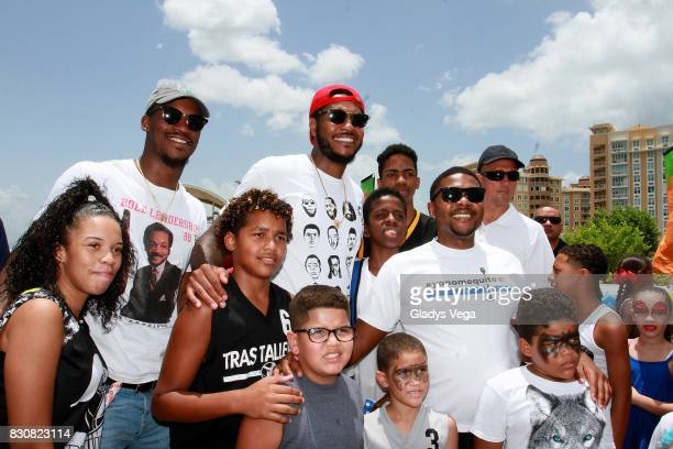 Jimmy Butler and Carmelo Anthony pose with kids as part of Worldwide Day of Play at Bahia Urbana Bay Side Park on August 12 2017 in San Juan Puerto...