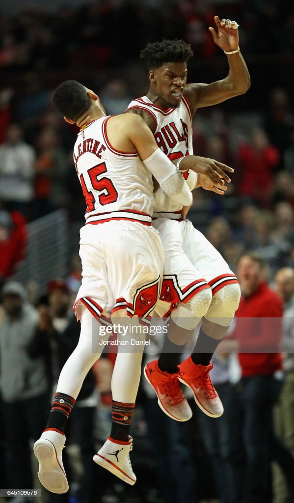 Jimmy Butler #21 and Denzel Valentine #45 of the Chicago Bulls celebrate after Butler hit a three point shot late in the fourth quarter against the Phoenix Suns at the United Center on February 24, 2017 in Chicago, Illinois. The Bulls defeated the Suns 128-121 in overtime.