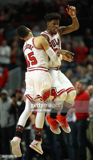 Jimmy Butler and Denzel Valentine of the Chicago Bulls celebrate after Butler hit a three point shot late in the fourth quarter against the Phoenix...