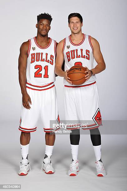 Jimmy Butler and Doug McDermott of the Chicago Bulls of the Chicago Bulls poses for a portrait during Media Day on September 28 2015 at the Advocate...