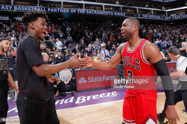 Jimmy Butler and Dwyane Wade of the Chicago Bulls high five during the game against the Sacramento Kings on February 6 2017 at Golden 1 Center in...