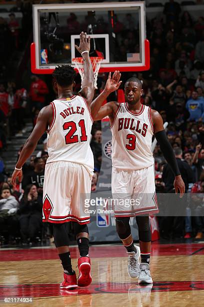 Jimmy Butler and Dwyane Wade of the Chicago Bulls highfive during a game against the New York Knicks on November 4 2016 at the United Center in...