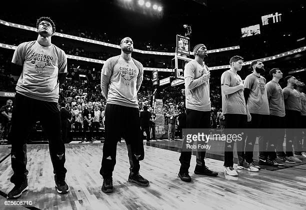 Jimmy Butler and Dwyane Wade of the Chicago Bulls line up with Bulls teammates before the game against the Miami Heat at American Airlines Arena on...