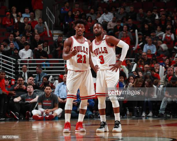 Jimmy Butler and Dwyane Wade of the Chicago Bulls talk during a game against the Orlando Magic on April 10 2017 at the United Center in Chicago...