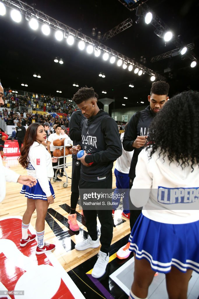 Jimmy Butler #23 and Karl-Anthony Towns #32 of Team Stephen sign autographs during the NBA All-Star practice as part of the 2018 NBA All-Star Weekend on February 17, 2018 at the Verizon Up Arena at the LACC in Los Angeles, California.
