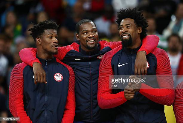 Jimmy Butler Kevin Durant and DeAndre Jordan of the United States react on the podium after defeating Serbia in the Men's Gold medal game on Day 16...