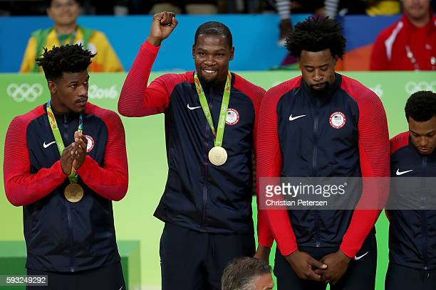 Jimmy Butler Kevin Durant and DeAndre Jordan of the United States pose with their gold medals following the Men's Gold medal game on Day 16 of the...