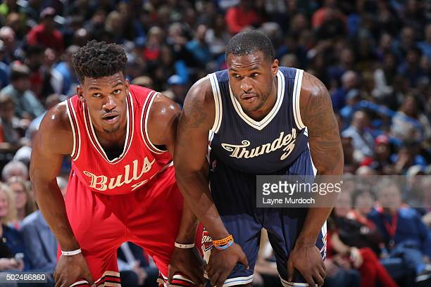 Jimmy Butler of the Chicago Bulls and Dion Waiters of the Oklahoma City Thunder box out on December 25 2015 at Chesapeake Energy Arena in Oklahoma...