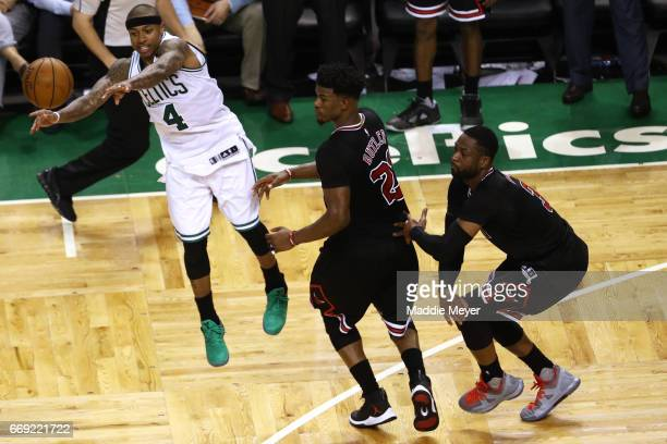 Jimmy Butler of the Chicago Bulls and Dwyane Wade defend a pass by Isaiah Thomas of the Boston Celtics during the fourth quarter of Game One of the...