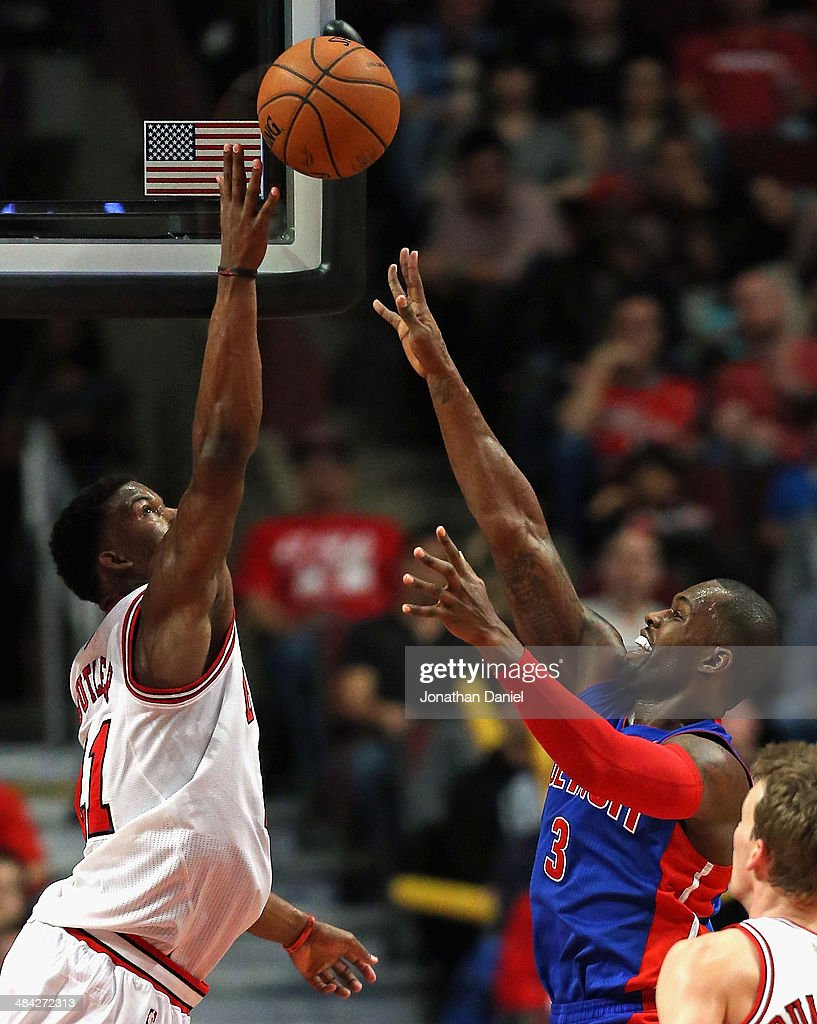 Jimmy Butler #21 of the Chicago Bulls blocks a shot by Rodney Stuckey #3 of the Detroit Pistons at the United Center on April 11, 2014 in Chicago, Illinois. The Bulls defeated the Pistons 106-98.