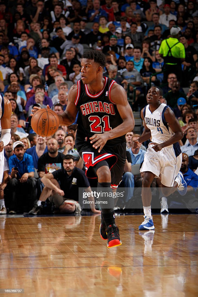 <a gi-track='captionPersonalityLinkClicked' href=/galleries/search?phrase=Jimmy+Butler+-+Basketball+Player&family=editorial&specificpeople=9860567 ng-click='$event.stopPropagation()'>Jimmy Butler</a> #21 of the Chicago Bulls brings the ball up court against the Dallas Mavericks on March 30, 2013 at the American Airlines Center in Dallas, Texas.