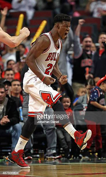 Jimmy Butler of the Chicago Bulls celebrates a threepoint play against the Atlanra Hawks during a preseason game at the United Center on October 16...