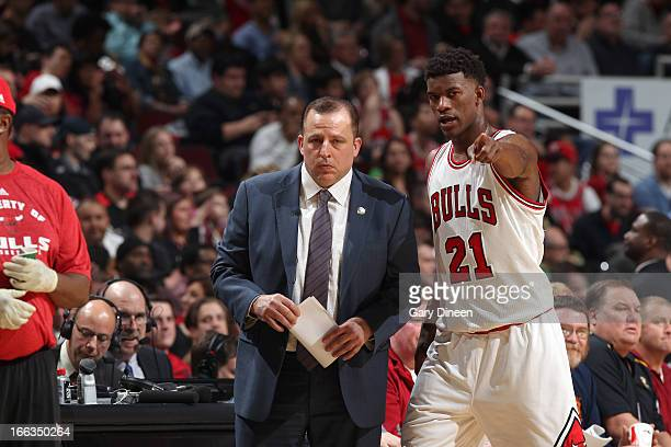 Jimmy Butler of the Chicago Bulls confers with Head Coach Tom Thibodeau during a break in action against New York Knicks on April 11 2013 at the...