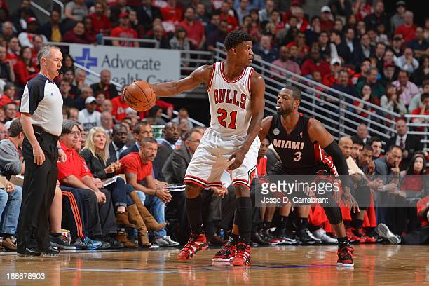 Jimmy Butler of the Chicago Bulls controls the ball against Dwyane Wade of the Miami Heat in Game Four of the Eastern Conference Semifinals during...