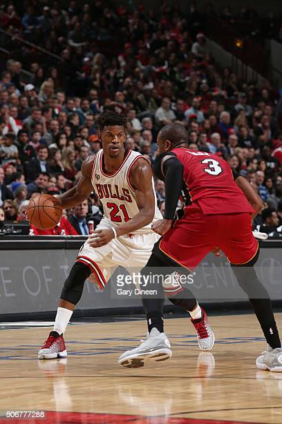 Jimmy Butler of the Chicago Bulls defends the ball against Dwyane Wade of the Miami Heat during the game on January 26 2016 at United Center in...