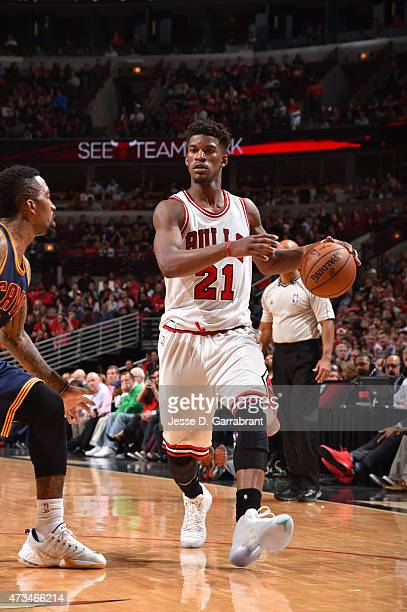 Jimmy Butler of the Chicago Bulls dribbles the ball against the Cleveland Cavaliers at the United Center During Game Six of the Eastern Conference...