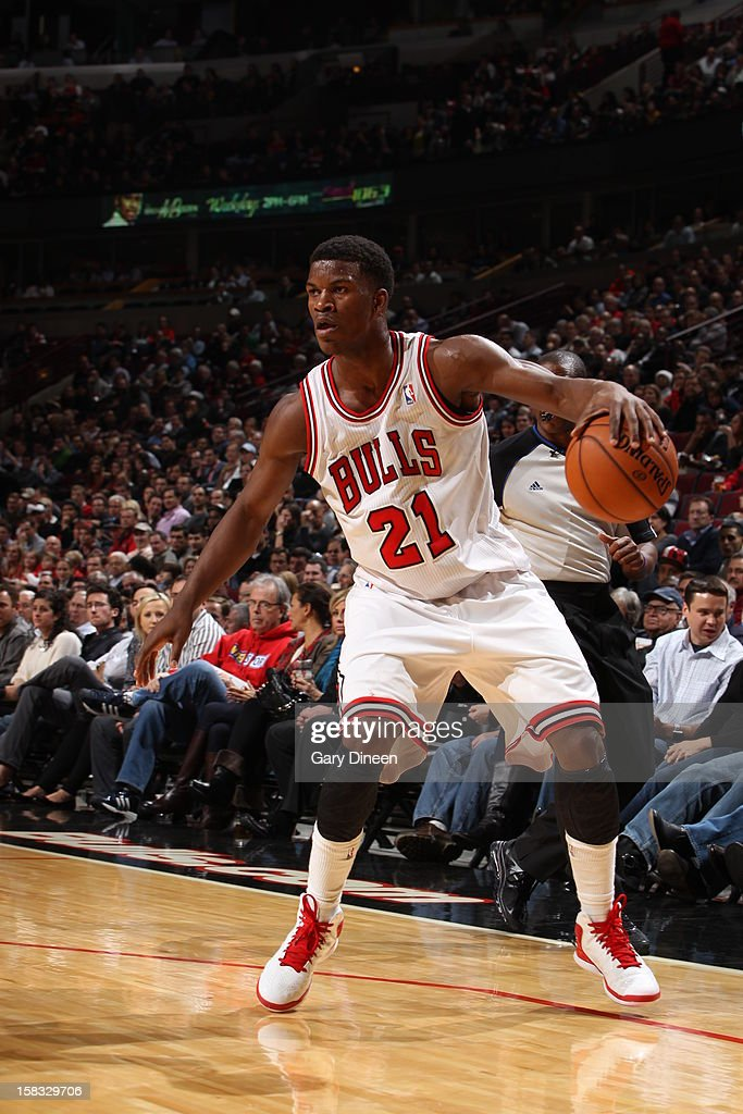 <a gi-track='captionPersonalityLinkClicked' href=/galleries/search?phrase=Jimmy+Butler+-+Basketball+Player&family=editorial&specificpeople=9860567 ng-click='$event.stopPropagation()'>Jimmy Butler</a> #21 of the Chicago Bulls dribbles the ball against the Indiana Pacers on December 4, 2012 at the United Center in Chicago, Illinois.