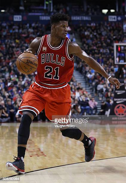 Jimmy Butler of the Chicago Bulls dribbles the ball during an NBA game against the Toronto Raptors at the Air Canada Centre on January 03 2016 in...