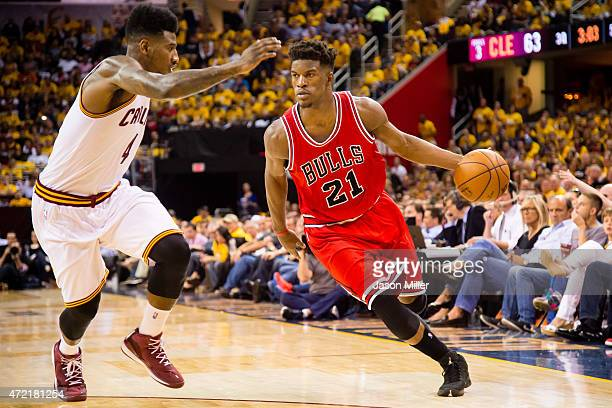 Jimmy Butler of the Chicago Bulls drives against Iman Shumpert of the Cleveland Cavaliers in the second half during Game One in the Eastern...
