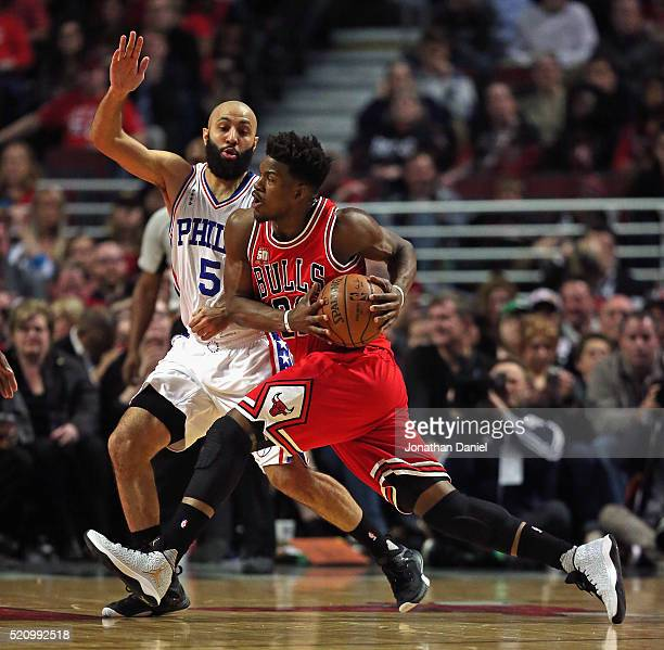 Jimmy Butler of the Chicago Bulls drives against Kendall Marshall of the Philadelphia 76ers at the United Center on April 13 2016 in Chicago Illinois...