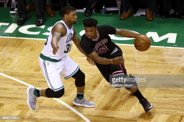 Jimmy Butler of the Chicago Bulls drives against Marcus Smart of the Boston Celtics during the third quarter of Game One of the Eastern Conference...