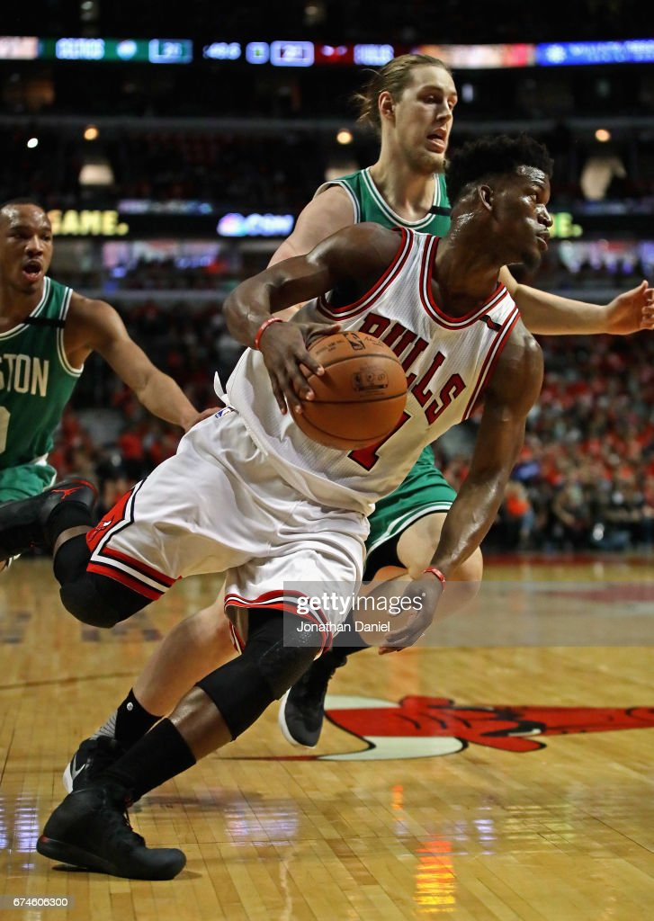 Jimmy Butler #21 of the Chicago Bulls drives around Kelly Olynyk #41 of the Boston Celtics during Game Six of the Eastern Conference Quarterfinals during the 2017 NBA Playoffs at the United Center on April 28, 2017 in Chicago, Illinois.