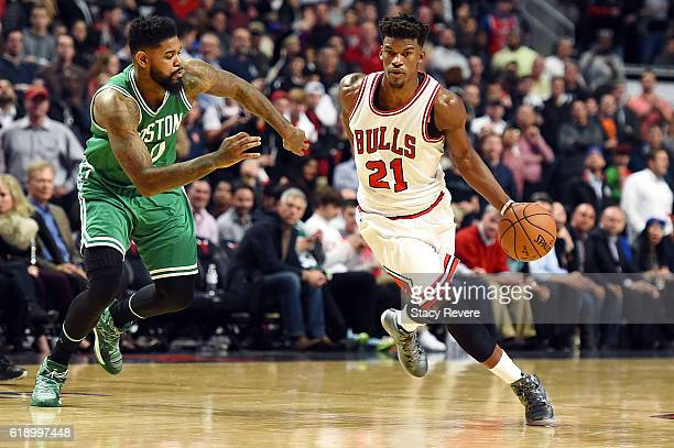Jimmy Butler of the Chicago Bulls drives to the basket against Amir Johnson of the Boston Celtics during the second half of a game at the United...