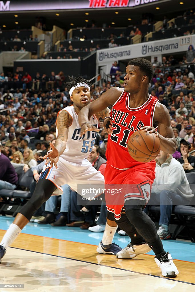 <a gi-track='captionPersonalityLinkClicked' href=/galleries/search?phrase=Jimmy+Butler+-+Basketball+Player&family=editorial&specificpeople=9860567 ng-click='$event.stopPropagation()'>Jimmy Butler</a> #21 of the Chicago Bulls drives to the basket against <a gi-track='captionPersonalityLinkClicked' href=/galleries/search?phrase=Chris+Douglas-Roberts&family=editorial&specificpeople=728571 ng-click='$event.stopPropagation()'>Chris Douglas-Roberts</a> #55 of the Charlotte Bobcats at the Time Warner Cable Arena on January 25, 2014 in Charlotte, North Carolina.