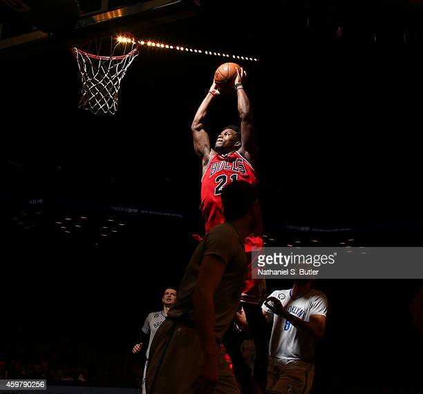 Jimmy Butler of the Chicago Bulls drives to the basket against the Brooklyn Nets during a game between the Chicago Bulls and the Brooklyn Nets at...