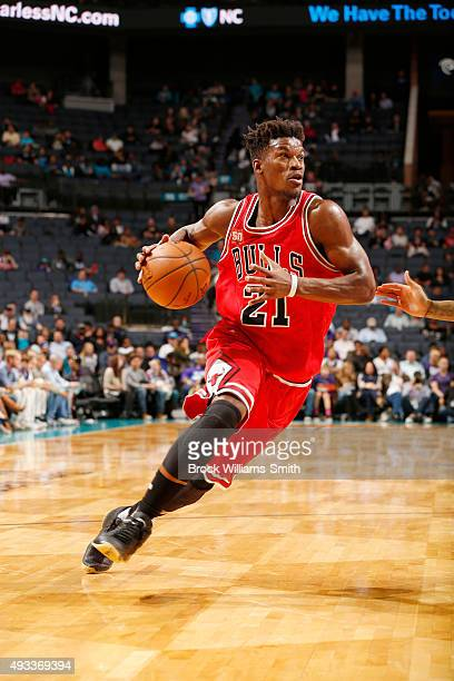 Jimmy Butler of the Chicago Bulls drives to the basket against the Charlotte Hornets during a preseason game at the Time Warner Cable Arena on...
