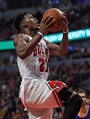 Jimmy Butler of the Chicago Bulls drives to the basket against the New York Knicks at the United Center on January 1 2016 in Chicago Illinois The...