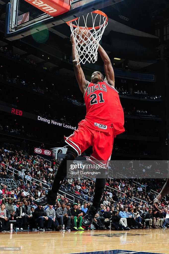 Jimmy Butler #21 of the Chicago Bulls dunks against the Atlanta Hawks on December 22, 2012 at Philips Arena in Atlanta, Georgia.