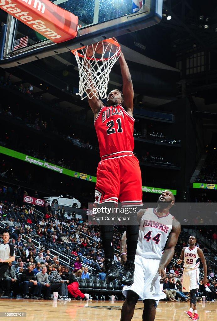 Jimmy Butler #21 of the Chicago Bulls dunks against the Atlanta Hawks on December 22, 2012 at Philips Arena in Atlanta, Georgia.