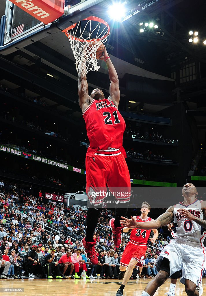 Jimmy Butler #21 of the Chicago Bulls dunks against the Atlanta Hawks on April 2, 2014 at Philips Arena in Atlanta, Georgia.