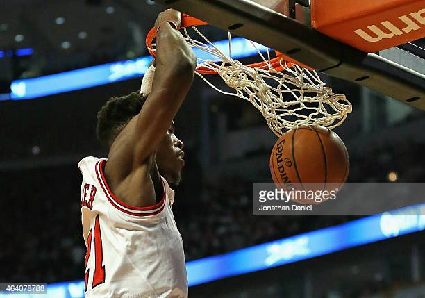 Jimmy Butler of the Chicago Bulls dunks against the Phoenix Suns at the United Center on February 21 2015 in Chicago Illinois NOTE TO USER User...