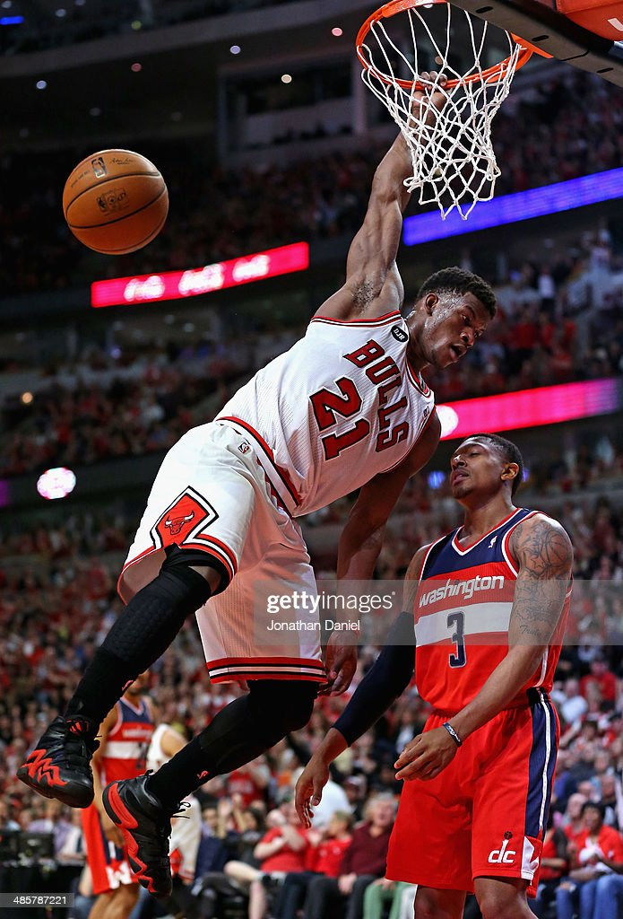 <a gi-track='captionPersonalityLinkClicked' href=/galleries/search?phrase=Jimmy+Butler+-+Basketball+Player&family=editorial&specificpeople=9860567 ng-click='$event.stopPropagation()'>Jimmy Butler</a> #21 of the Chicago Bulls dunks over <a gi-track='captionPersonalityLinkClicked' href=/galleries/search?phrase=Bradley+Beal&family=editorial&specificpeople=7640439 ng-click='$event.stopPropagation()'>Bradley Beal</a> #3 of the Washington Wizards in Game One of the Eastern Conference Quarterfinals during the 2014 NBA Playoffs at the United Center on April 20, 2014 in Chicago, Illinois. The Wizards defeated the Bulls 102-93.