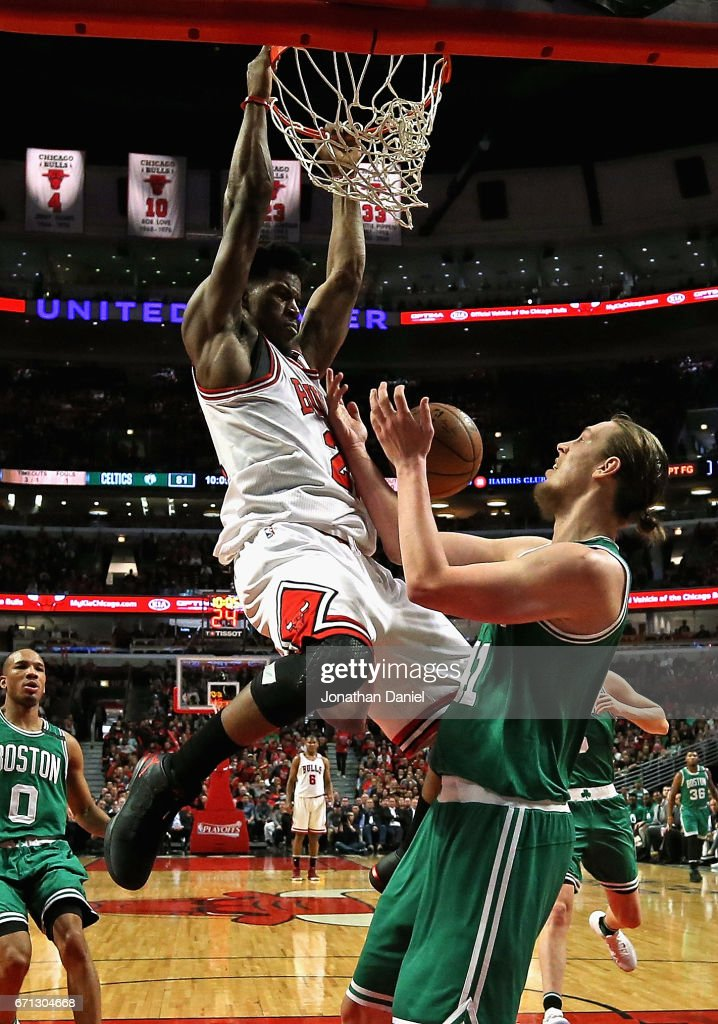 Jimmy Butler #21 of the Chicago Bulls dunks over Kelly Olynyk #41 of the Boston Celtics during Game Three of the Eastern Conference Quarterfinals during the 2017 NBA Playoffs at the United Center on April 21, 2017 in Chicago, Illinois. The Celtics defeated the Bulls 104-87.