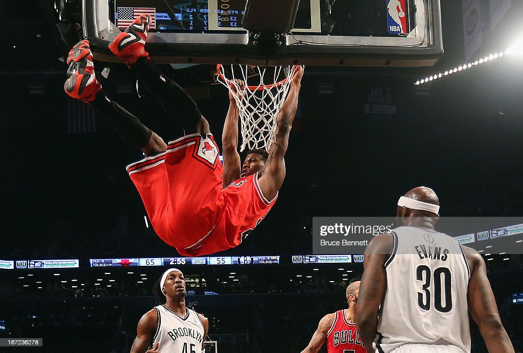 Jimmy Butler #21 of the Chicago Bulls finishes up a slam dunk against the Brooklyn Nets during Game Two of the Eastern Conference Quarterfinals of the 2013 NBA Playoffs at the Barclays Center on April 22, 2013 in New York City. The Bulls defeated the Nets 90-82.
