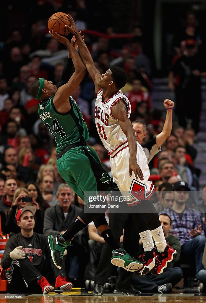 Jimmy Butler #21 of the Chicago Bulls fouls Paul Pierce #34 of the Boston Celtics at the United Center on December 18, 2012 in Chicago, Illinois. The Bulls defeated the Celtics 100-89.