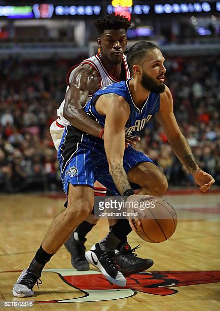 Jimmy Butler of the Chicago Bulls gets his arm around Evan Fournier of the Orlando Magic at the United Center on November 7 2016 in Chicago Illinois